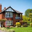 Typical English house with a garden — Stock Photo #15892945