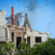 Ruined house after the disaster - Stock Photo