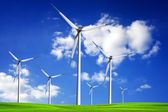 Wind turbine on spring field — Stock Photo