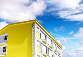 Sunny house on blue sky — Stock Photo
