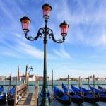 Gondolas moored by Saint Mark square — Stock Photo #23786441