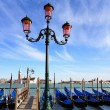 Gondolas moored by Saint Mark square — Stock Photo #23786441