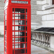 British red phone box on a London street  — Stock Photo