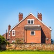 Typical English house on blue sky — Stock Photo