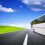 Tourist bus traveling — Stock Photo