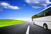 Tourist bus traveling — Stock Photo