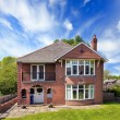 Typical red brick house — Stock Photo #34562125