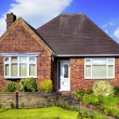 Red brick house with garden — Stock Photo