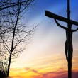 图库照片: Jesus on the cross at sunset