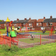 Playground and typical English buildings — Stock Photo