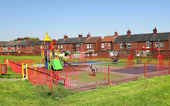 Playground and typical English buildings — Stockfoto