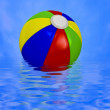 Beach ball on water — 图库照片