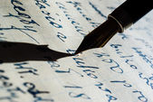 Fountain golden pen and paper background — Stock Photo