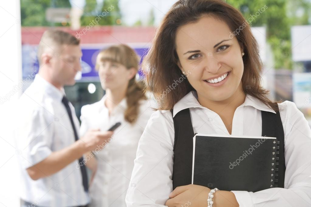 Portrait of young pretty woman in business environment  Stockfoto #12584412