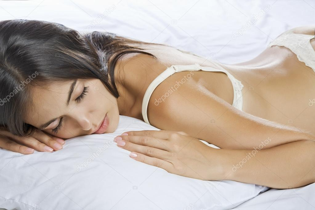 Portrait of young beautiful woman on white sheet — Stock Photo #12584973
