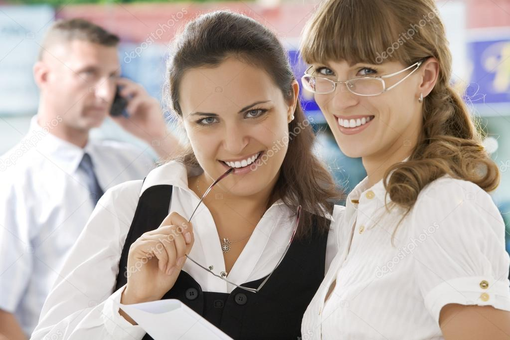 Portrait of young pretty women having  conversation  in office environment — Stock Photo #12585695