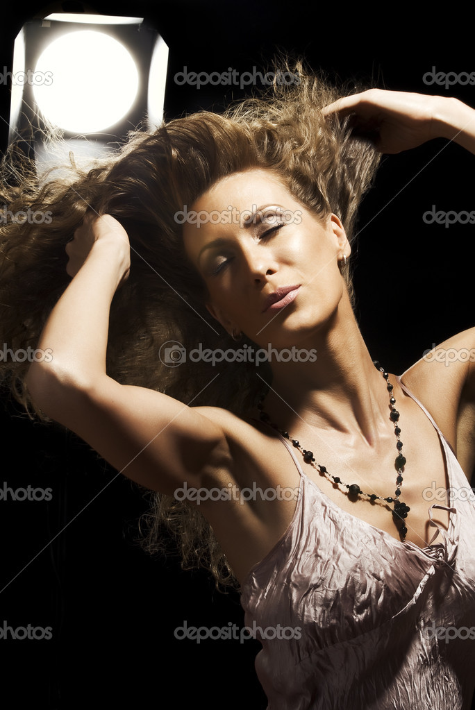 Portrait  of young beautiful woman on black background — Stock Photo #12585781