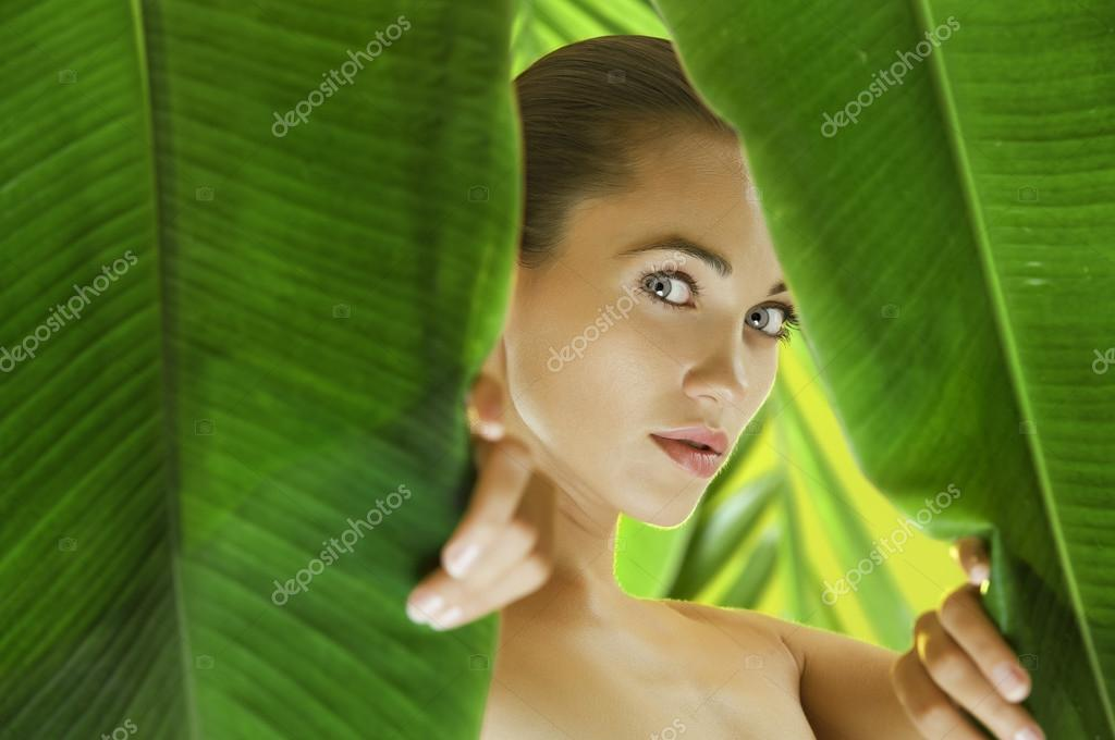 Portrait of young beautiful woman getting through the jungle  Stock Photo #12586680