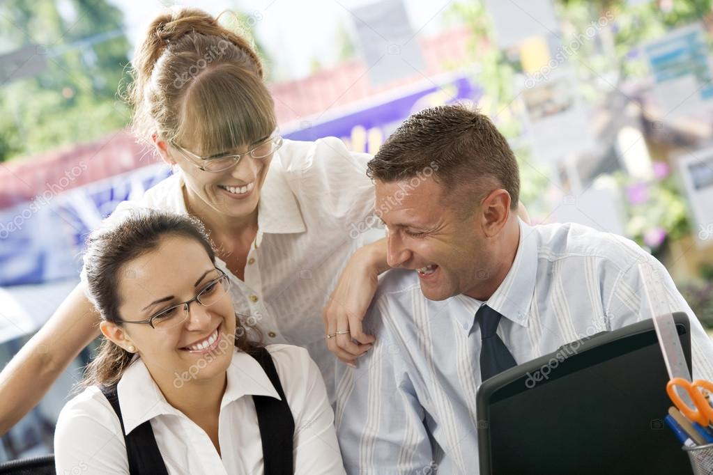 Portrait of young business discussing project in office environment  Stock Photo #12619912