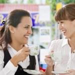 Portrait of young pretty women having coffee break in office environment — Stock Photo #12622246