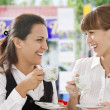 Royalty-Free Stock Photo: Portrait of young pretty women having coffee break in office environment