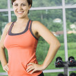Stock Photo: Portrait of young nice woman getting busy in gym