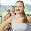 Portrait of young nice getting busy in gym — Stockfoto