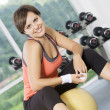 Portrait of young nice woman getting busy in gym — Stock Photo #12623067