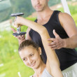 Portrait of young nice couple getting busy in gym - Stock fotografie