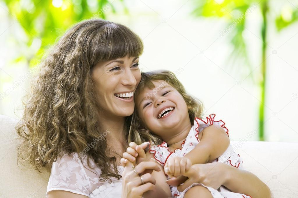 Portrait of happy mother with daughter  having good time in summer environment — Stock Photo #12622008