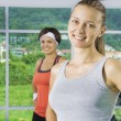 Portrait of young nice women getting busy in gym — Stock Photo #12765638