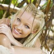 Stock Photo: Portrait of young pretty woman in summer environment