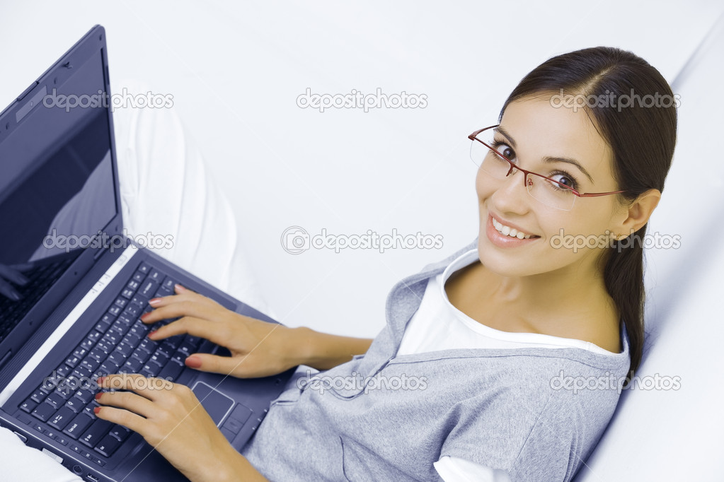 Portrait of young beautiful woman with her laptop — Stock Photo #12765266