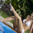 Portrait of young attractive woman having good time in tropic environment - Stockfoto