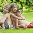Portrait of little kids having good time in summer environment - Stockfoto