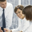 Portrait of young business getting busy in office environment — Stock Photo #13200891