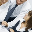 Portrait of young business discussing project in office environment — Stock Photo #13200916