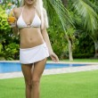 Stok fotoğraf: Portrait of young attractive woman having good time in tropic environment
