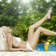 Portrait of young attractive woman having good time in tropic environment — Stock Photo