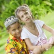 Portrait of little kids having good time in summer environment - Stock Photo