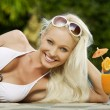 Portrait of young attractive woman having good time in tropic environment — Stok fotoğraf