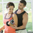 Stock Photo: Portrait of young nice couple getting busy in gym