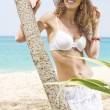 Portrait of beautiful girl having good time on tropical beach — Stok fotoğraf