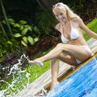 Stock Photo: Portrait of young attractive woman having good time in tropic environment