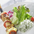 close up view of nice delicious shish kebab on white back — Stock Photo