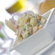 Close up view of nice delicious salad on white back - Foto Stock