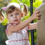 Portrait of little girl having good time in summer environment — Stock Photo #13707418