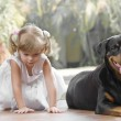 Portrait of little girl having good time with her dog — Stock Photo #13708052