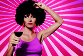 Pop art like image of young nice woman with glass of wine on pink back — Stock Photo