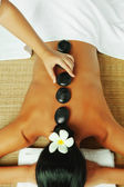 Close up view of spa procedure on color back — Stock Photo